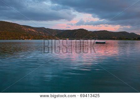 Boat On Reservoir At Dusk