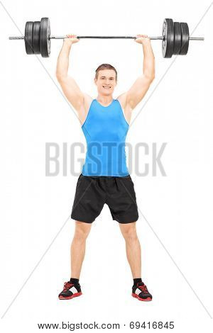 Full length portrait of a male weightlifter holding a barbell isolated on white background