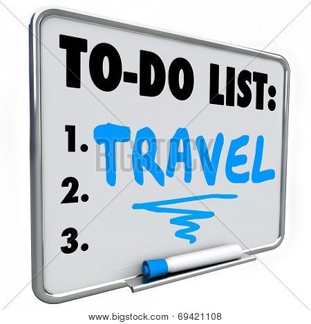 Travel word written on a dry erase board with blue marker as a priority or goal to reach in your life