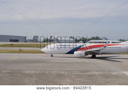 KUCHING - MAY 06: Boeing 737 of Malaysian Airline in airport on May 06, 2014 in Kuching, Malaysia. Malaysian Airline System is a major airline operating flights from Kuala Lumpur International Airport