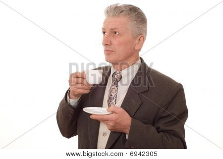 Businessman Drinking From A Cup On A White Background