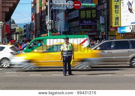 Traffic Warden Directs Peak Hour Traffic In Tapei