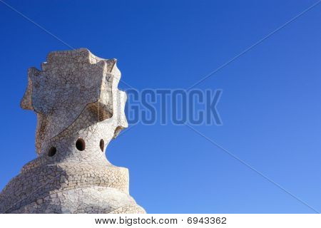 Cross-shaped chimney created by Antonio Gaudi. La Pedrera or Casa Mila. Barcelona