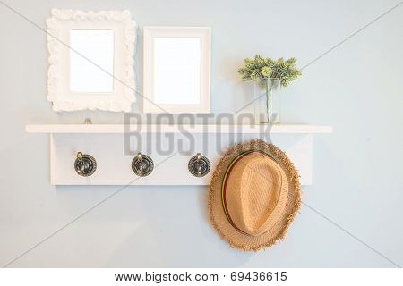 Hat Hang On The  Wall With Picture Frames