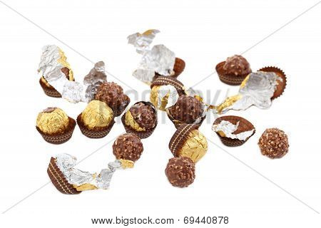 Bunch of chocolate gold bonbons.
