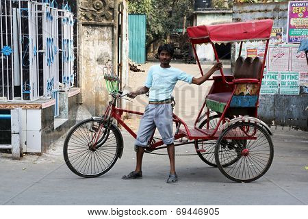 KOLKATA - FEB 10: rickshaw driver working on February 10, 2014 in Kolkata, India. Rickshaws have been around for more than a century, but they could soon be a thing of the past.