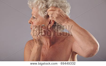Senior Woman Wearing A Hearing Aid
