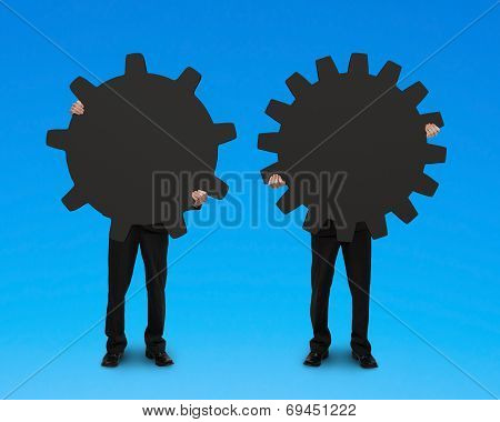 Businessmen Holding Two Gears For Connecting