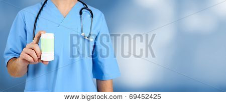 Doctor with pills at hospital