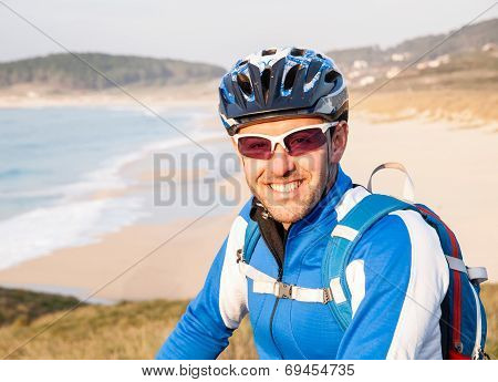 Cyclist Smiling And Looking At Camera