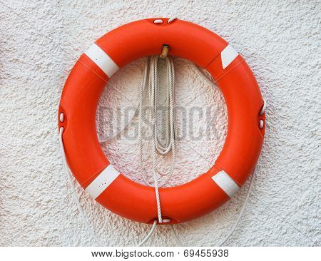 Red lifebuoy on the wall