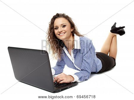 Successful Businesswoman Laying On The Floor In Front Of Her Laptop Browsing