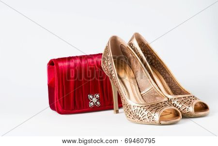 Woman Gold Shoes On Background Whit Red Purse