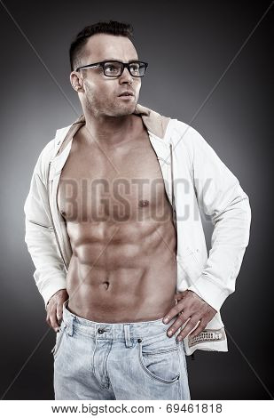 Fashionable Sexy Man Wearing An Unbuttoned Shirt And Eyeglasses