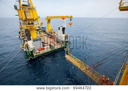 Crane on barge for in stall the platform in oil and gas industry, Heavy job when move critical lift