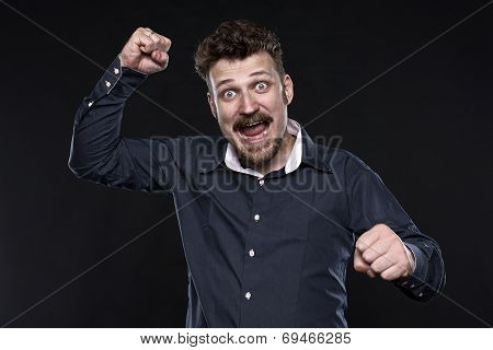 Angry happy bearded man punch his enemies looking straight to the camera