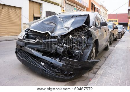 VALENCIA, SPAIN - AUGUST 4, 2014: A crash car parked on the street in Valencia waiting for repair. A 1985 study by K. Rumar, found that 57% of car crashes were due solely to driver error.