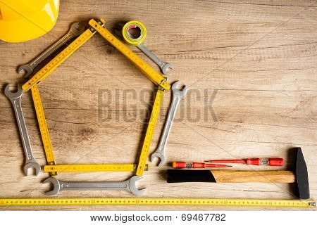 construction background, different tools on the wood plank.