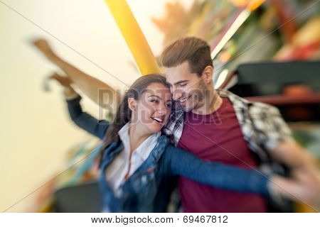 happy love couple enjoy in riding ferris wheel