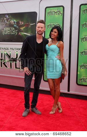 LOS ANGELES - AUG 3:  Brian Tyler, Venus Marie at the Teenage Mutant Ninja Turtles Premiere at the Village Theater on August 3, 2014 in Westwood, CA