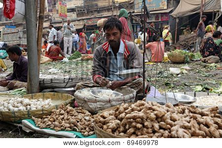 KOLKATA, INDIA - FEBRUARY 11: Street trader sell vegetables outdoor on February 11, 2014 in Kolkata India. Only 0.81% of the Kolkata's workforce employed in the primary sector (agriculture)