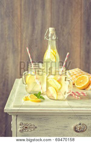 Homemade lemonade drinks with straws - vintage filter effect added