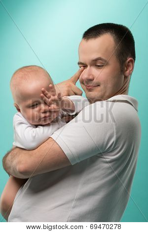 Father holding his baby boy