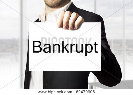 Businessman Holding Sign Bankrupt