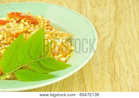 Close Up Green Papaya Salad With Leaves Of Gooseberry