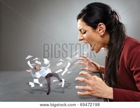 Furious Businesswoman Shouting At A Subordinate