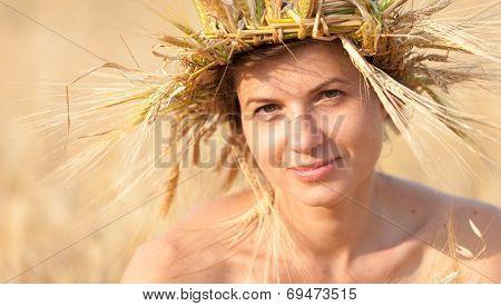 Woman In Field Of Wheat
