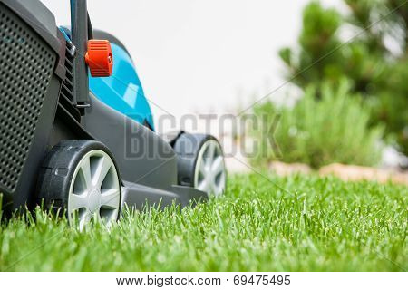 Lawn Mower On A Green Meadow