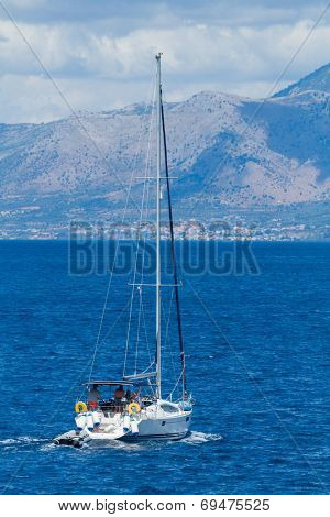 Sailing yacht around Lefkada island in Greece