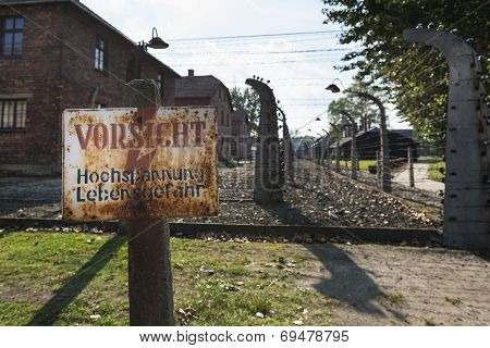 Careful, High-voltage, Danger Sign In Auschwitz Ii-birkenau Camp In Brzezinka