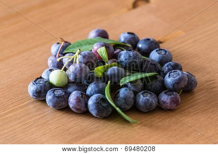 Pile Of Blueberries Lying On Wooden Table