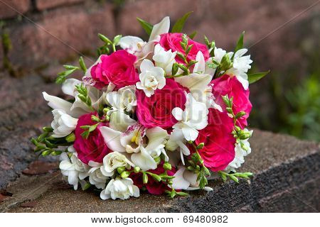 Bouquet of  flowers of white and red colors of orchids and roses for a wedding.