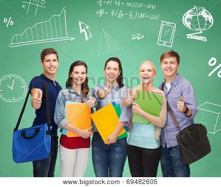 education, friendship and people concept - group of smiling students with folders and bags showing thumbs up over green board