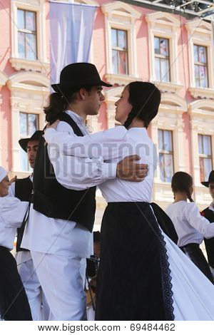 ZAGREB, CROATIA - JULY 20: Members of folk groups St. Jerome from Mala Strigova, Croatia during the 48th International Folklore Festival in center of Zagreb, Croatia on July 20, 2014
