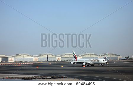 DUBAI, UAE - DECEMBER 09: Emirates Airbus A340 at Dubai Airport on December 09, 2012 in Dubai, UAE. Emirates handles major part of passenger traffic and aircraft movements at the airport.