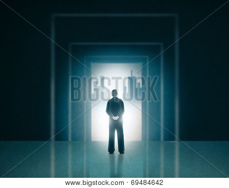 Man in Business Suit Standing on a Door Entrance