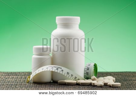 Supplements, Medications Or Vitamin Bottle With Spoon