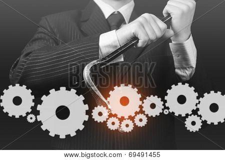 Businessman Holds Crowbar With Cogwheels, Monochrome Image
