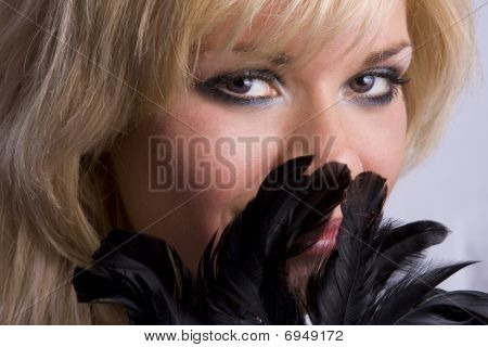 Close-up Of Beautiful Woman With Black Feather