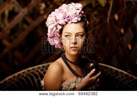 Retro woman. Girl in vintage style with flowers in the hairstyle