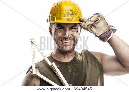 Portrait Of Dirty Worker With Helmet Measuring With Classic Wood Meter