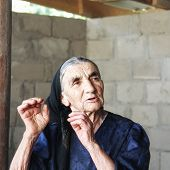 Gesticulating Elderly Woman