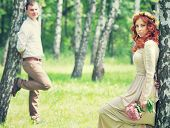 foto of birching  - Romantic gentle bride and handsome groom posing near birch trees - JPG