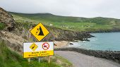 pic of cliffs moher  - Clare cliffs of Moher with danger sign and road - JPG