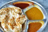 picture of malaysian food  - Roti canai flat bread Indian food made from wheat flour dough - JPG