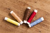 pic of thread-making  - The wood Background with many colored thread - JPG